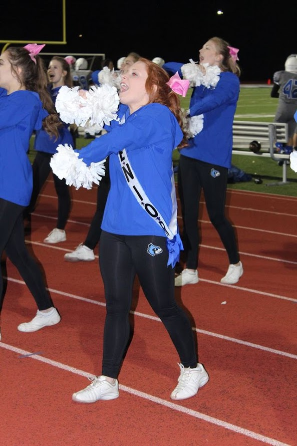 Senior cheerleader Emily Groppe cheers on the sideline at the Oct. 14 football game.