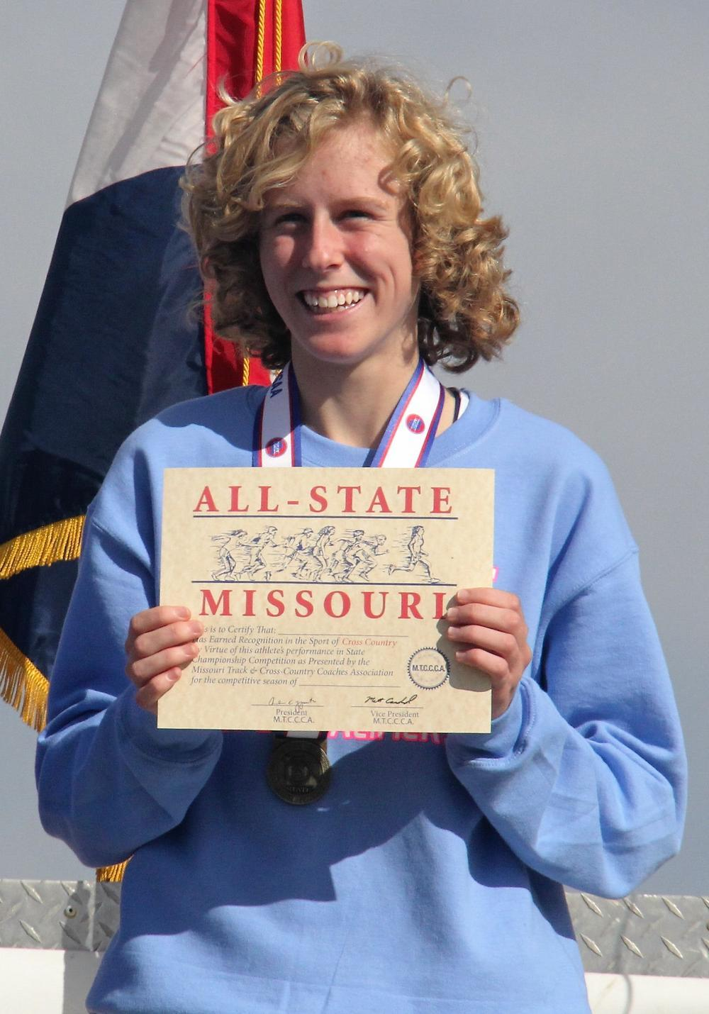 """Junior Mikayla Reed accepts her All-State Missouri title for cross-country. """"There are no words to describe what I felt after I crossed the finish line, knowing I had won State,"""" Reed said. Reed beat the second place finisher by 25 seconds."""