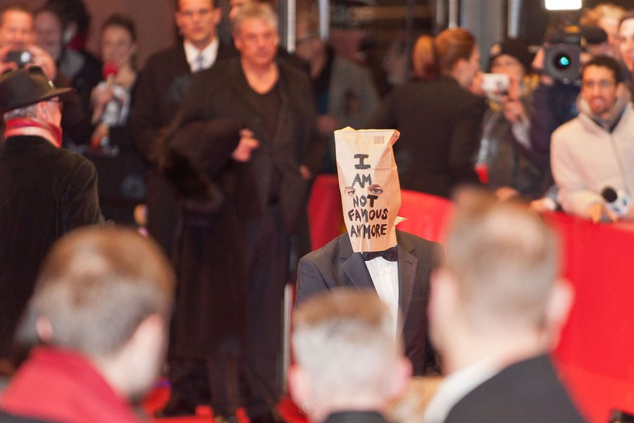 Shia+Labeouf+shows+up+to+the+2014+Berlin+Film+Festival+with+a+bag+over+his+head+with+the+words+%E2%80%9CI+AM+NOT+FAMOUS+ANYMORE%E2%80%9D+inscribed+on+the+bag.+This+later+turned+into+R%C3%B6nkk%C3%B6%2C+Turner+and+Labeouf+performing+for+six+days+at+a+Los+Angeles+art+exhibit.+This+piece+was+titled+%E2%80%9CIAMSORRY%E2%80%9D+and+became+the+first+of+several+projects+over+the+years.