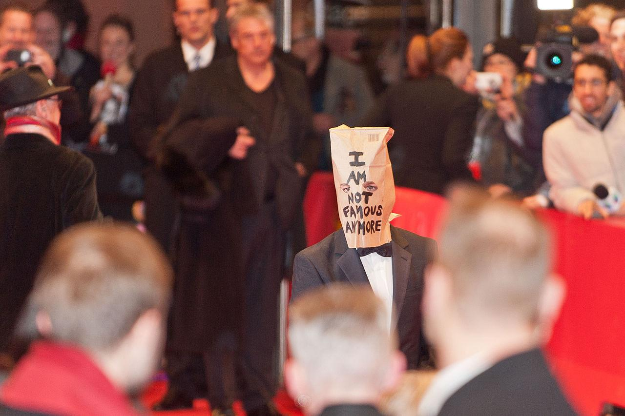 "Shia Labeouf shows up to the 2014 Berlin Film Festival with a bag over his head with the words ""I AM NOT FAMOUS ANYMORE"" inscribed on the bag. This later turned into Rönkkö, Turner and Labeouf performing for six days at a Los Angeles art exhibit. This piece was titled ""IAMSORRY"" and became the first of several projects over the years."