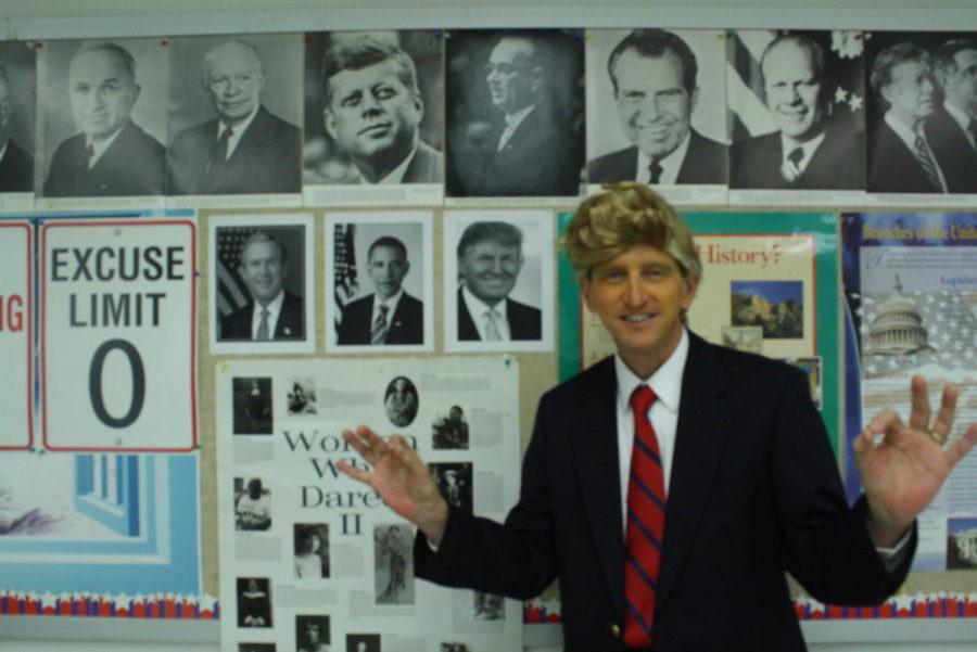 Social+studies+teacher+Ed+Stahl+poses+in+his+President+Trump+costume+on+Halloween.