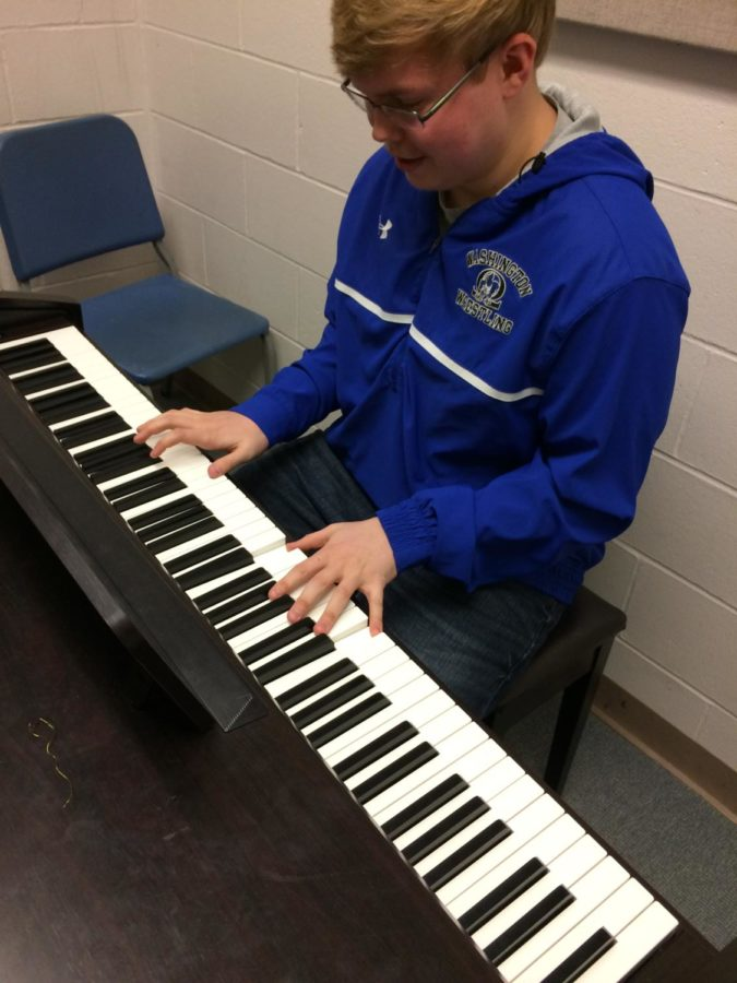 Junior Ryan Gratzer plays the piano.