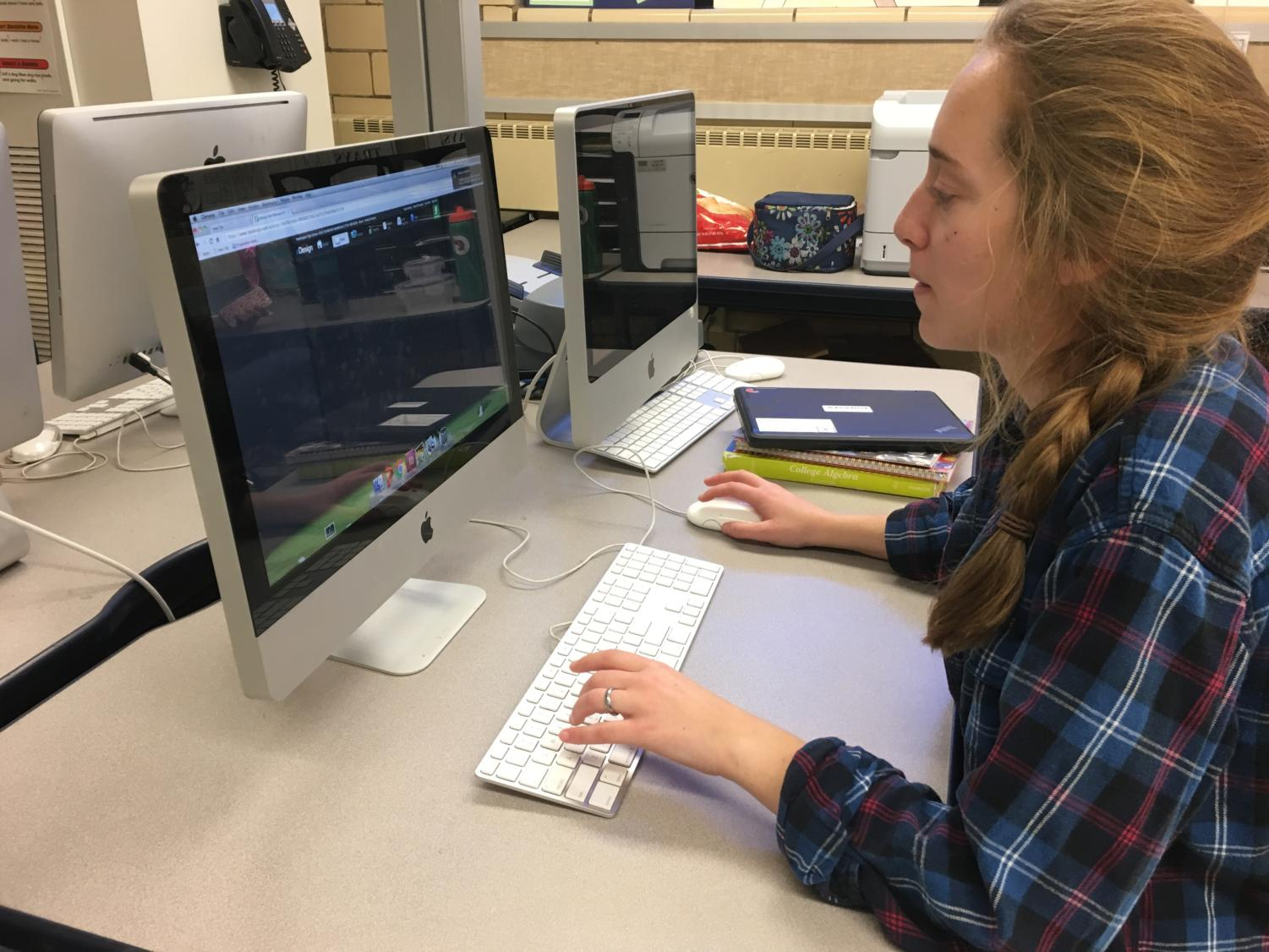 Senior Lydia Juengling works on her yearbook spread Monday, Nov. 27, 2017.