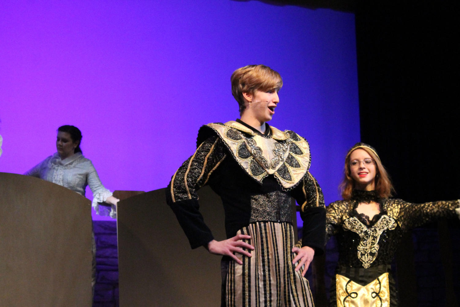 "Junior Ezra Miles performs as Lumiére in ""Beauty and the Beast"" during a November performance. ""Playing Lumiere was a blast,"" Miles said. ""I had so much fun using my lanky body for comedic purposes and hanging out with Ely working on our accents and jokes."" ""Beauty and the Beast"" was Miles' third musical at WHS."