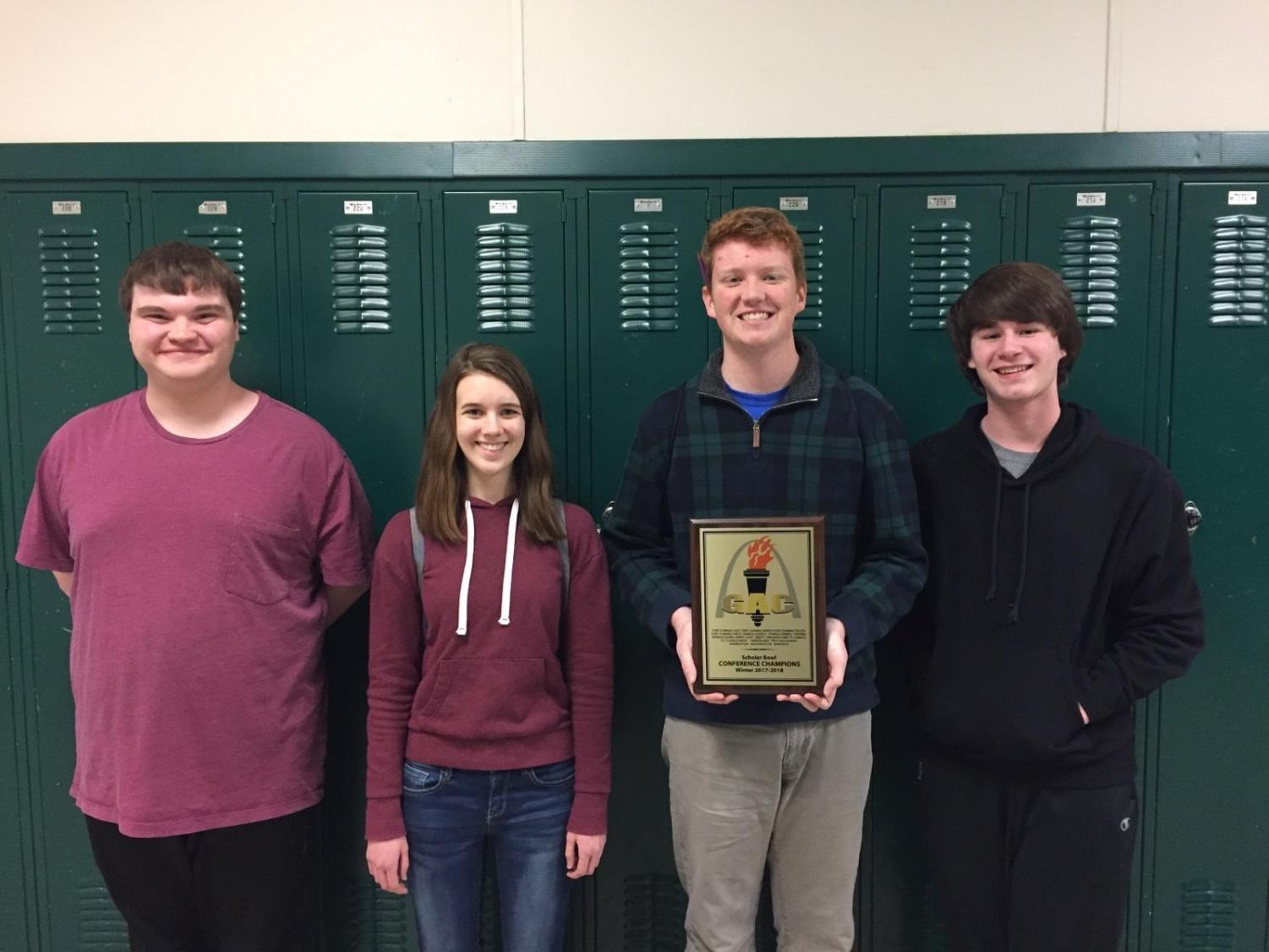 "The WHS Scholar Bowl A team poses with their trophy Feb. 10, 2018. ""It was awesome. I think for me the biggest thing I want to continue is the legacy that the guys before me did,"