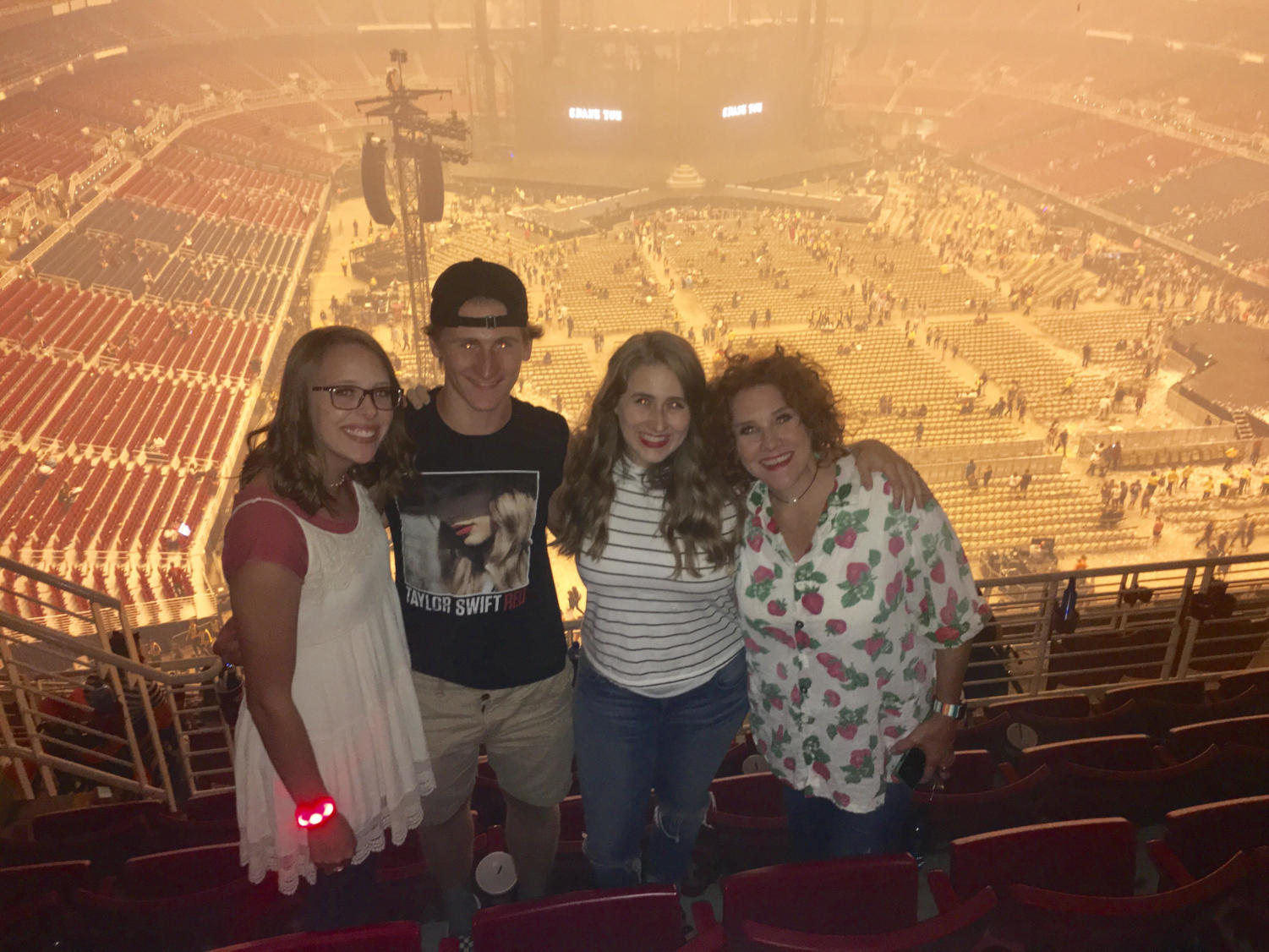 Madilynn Kipp poses with family friends before the Reputation Stadium Tour in St. Louis, Tuesday, Sept. 18.