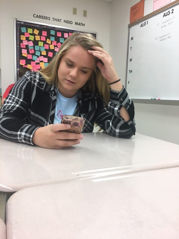 Junior Isabel Kimminau sits on her phone during the first day of EPIC hour Oct. 17.