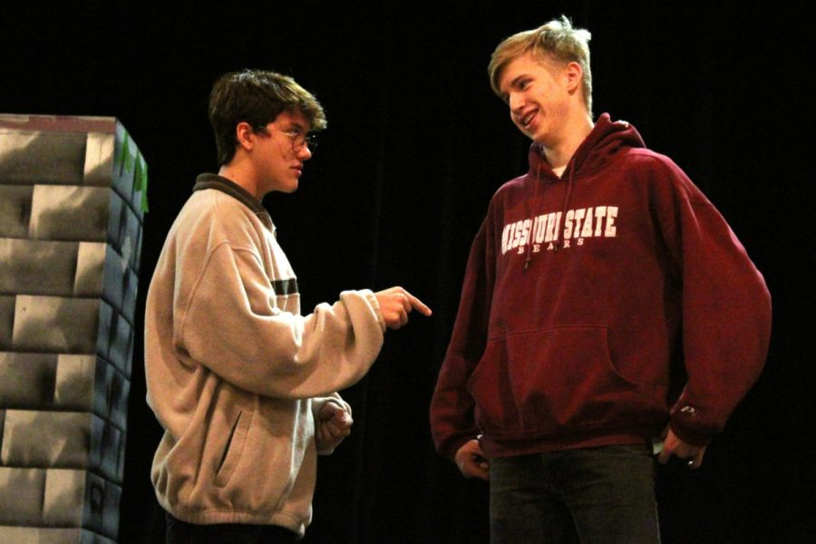 Junior+Drew+Post+%28left%29+and+senior+Ezra+Miles+%28right%29+rehearse+their+lines+at+a+theater+practice+Oct.+22+in+the+CJ+Burger+Fine+Arts+Center+in+preparation+for+their+upcoming+performances+in+%E2%80%9CGuys+and+Dolls%E2%80%9D+as+characters+Nathan+Detroit+and+Sky+Masterson.+%22My+favorite+thing+about+Nathan+is+he%27s+really+quick+on+his+feet%2C+so+if+he%27s+backed+into+a+corner%2C+he+doesn%27t+just+give+up%2C%22+Post+said.+%22He+can+really+swindle+people+or+come+up+with+some+sort+of+excuse.%22+The+theater+program+will+be+presenting+%E2%80%9CGuys+and+Dolls%E2%80%9D+from+Nov.+8-10+at+7+p.m.