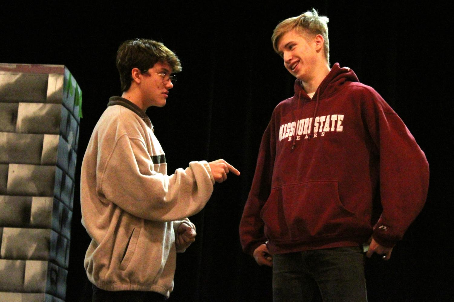 "Junior Drew Post (left) and senior Ezra Miles (right) rehearse their lines at a theater practice Oct. 22 in the CJ Burger Fine Arts Center in preparation for their upcoming performances in ""Guys and Dolls"" as characters Nathan Detroit and Sky Masterson."