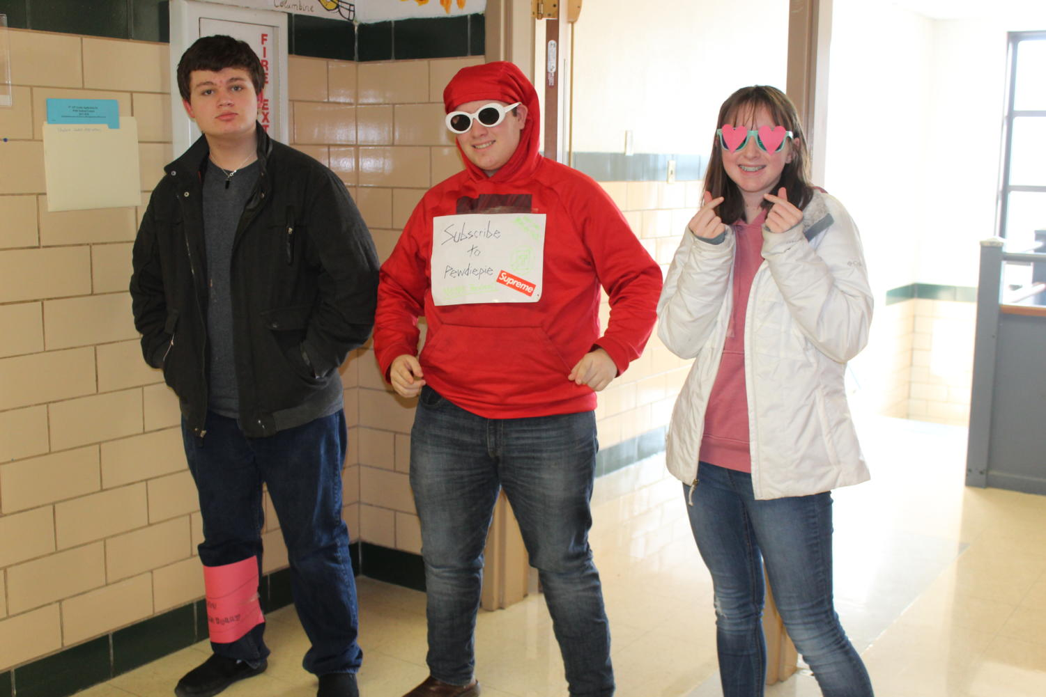 (Left to Right) Freshmen Ethan Upchurch dresses as a can of Cranberry Sprite, Frank Emma dresses as PEW NEWS and Cecelia Heimos dresses as Gin from BTS.