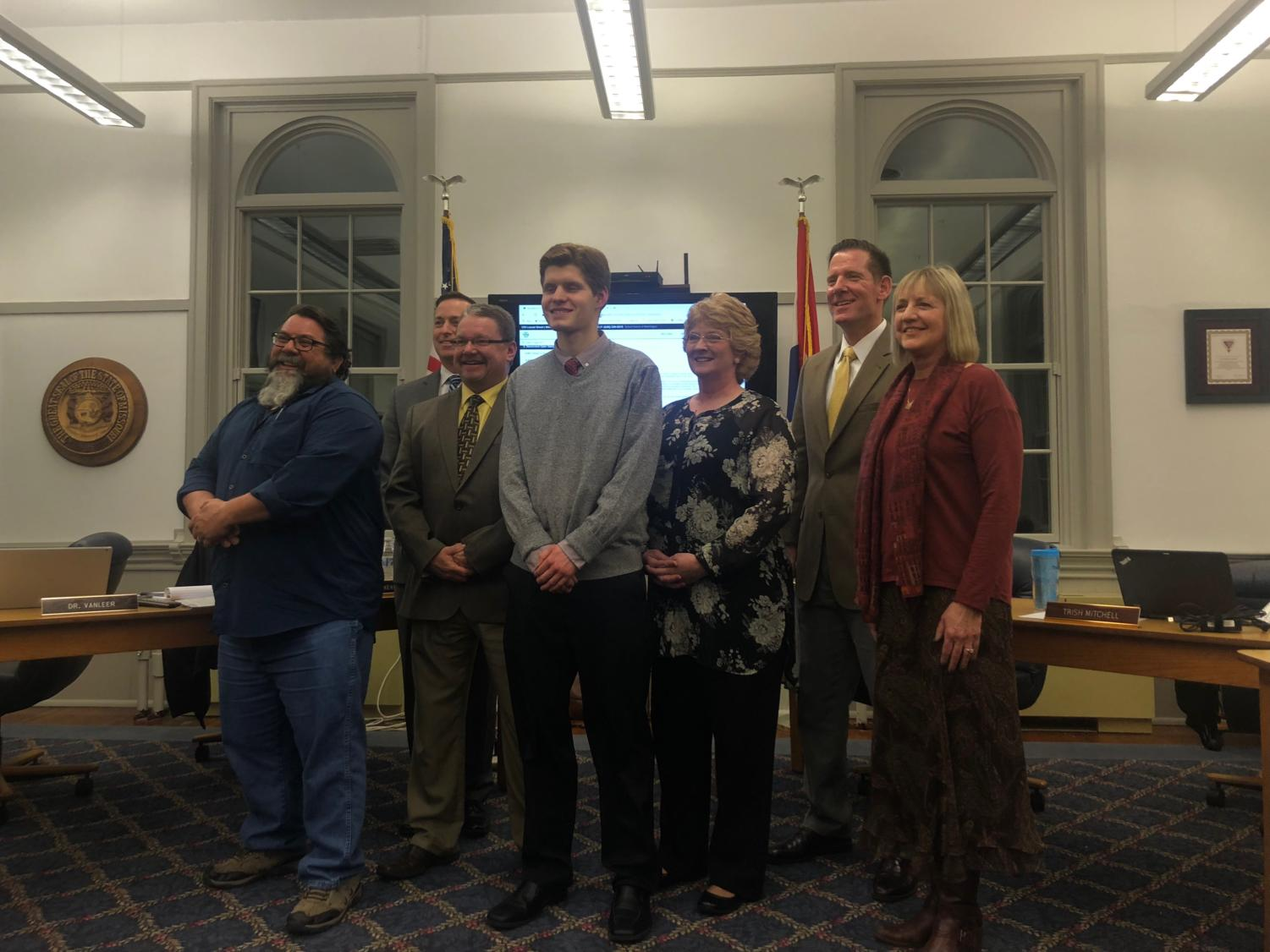 "Junior Tristan Zeh poses with the Board of Education after he is sworn in as the 2019 student board representative Jan. 23. ""It was very interesting in getting to see the reports they give, how the superintendents report to the board members and how that administrative side of running things look,"" Zeh said. Pictured from left to right is Kevin Blackburn, John Freitag, Scott Byrne, Zeh, Trish Mitchell, Bob Oreskovic and Susan Thatcher."