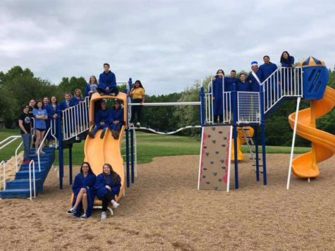 "Senior Joseph Bauer and other WHS seniors pose for a picture on the Marthasville Elementary School playground. ""The final picture of all of us on the playgrounds we used to play on as kids was probably the most memorable,"" Bauer said. Bauer still keeps in touch with his former elementary school classmates."