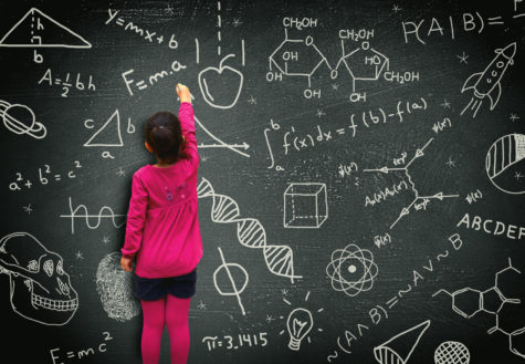 "A student writes on a chalkboard. ""If you can light the spark of curiosity in a child,"" educational expert Sir Kenneth Robinson said, ""they will learn without any further assistance, very often."" In Robinson's Ted Talk ""How to escape education's death valley,"" he described principles he believes will transform education in America."