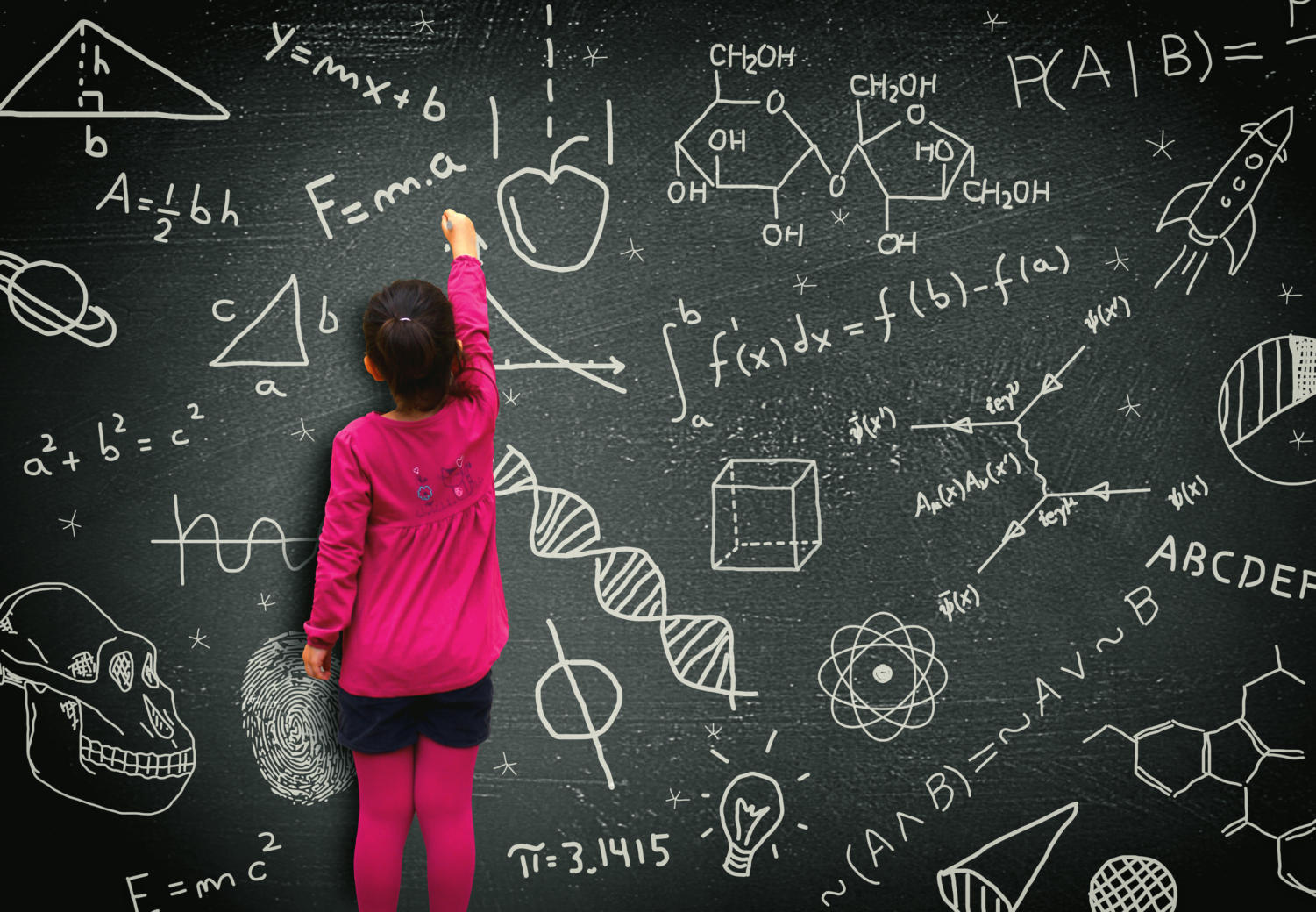 """A student writes on a chalkboard. """"If you can light the spark of curiosity in a child,"""" educational expert Sir Kenneth Robinson said, """"they will learn without any further assistance, very often."""" In Robinson's Ted Talk """"How to escape education's death valley,"""" he described principles he believes will transform education in America."""