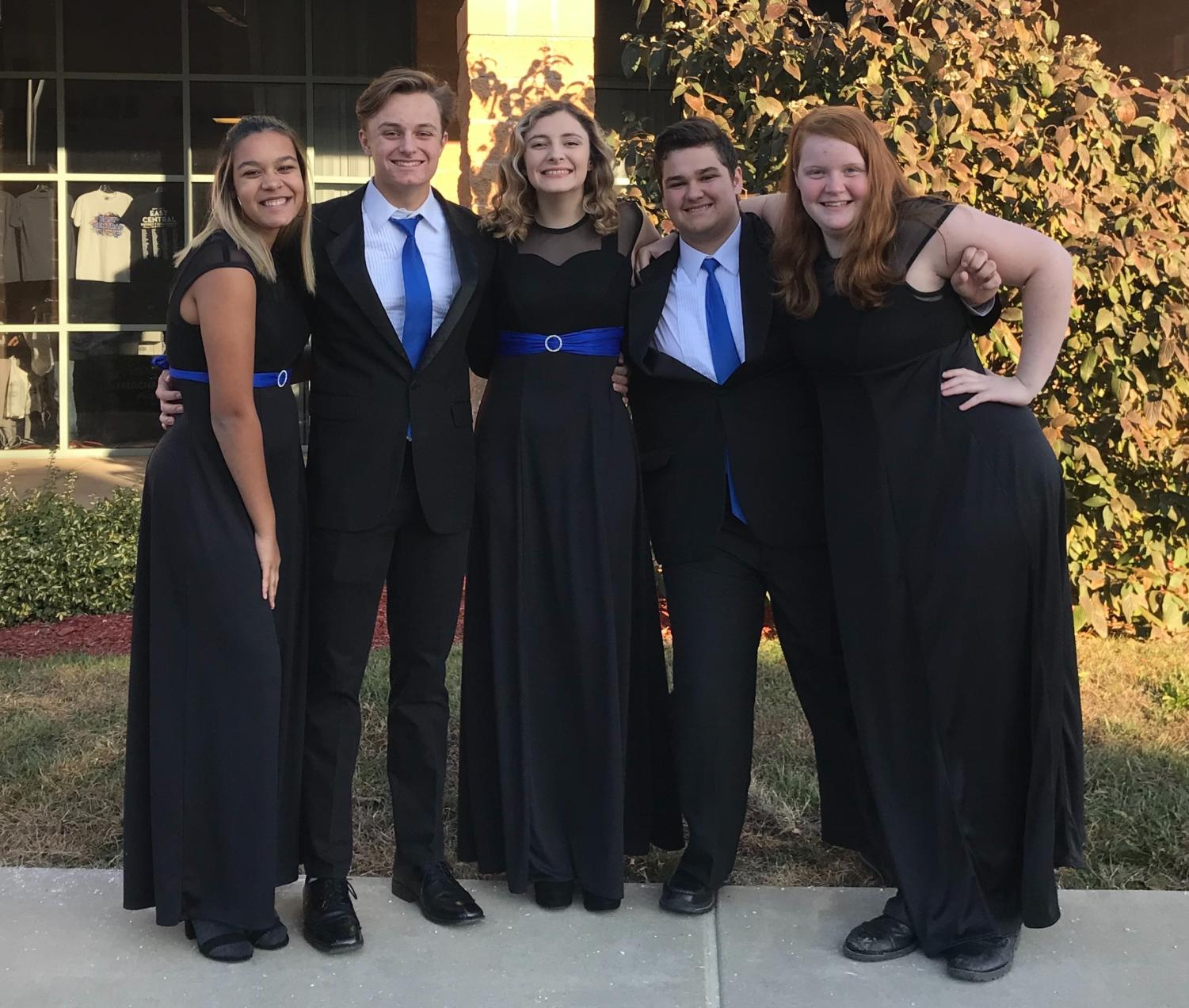 "WHS choir students Kayla Childs, Levi Weber, Morgan Sprehe, Evan Courtaway and Elizabeth Brennecke pose for a group photo at All District Choir. ""You make connections with people from around the area and it's really nice,"" Sprehe said. ""You get to be a part of something that you love doing, but on a bigger scale than just at school."" Last year, four students from WHS participated in All District Choir."