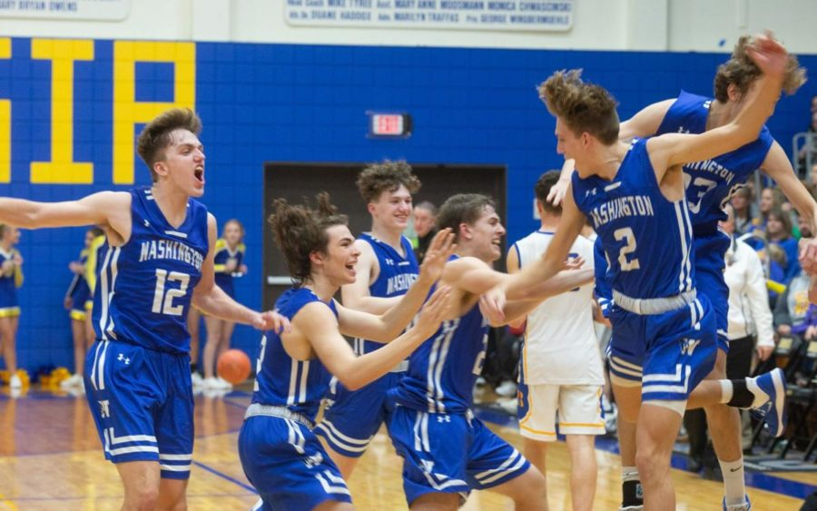 "The Blue Jays celebrate their victory over Borgia on Friday, Nov. 29 at St. Francis Borgia High School.  ""[The most exciting game] was probably my first game or the game against Borgia,"" junior forward Todd Bieg said. The Blue Jays are currently undefeated at 4-0."