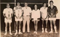 Mark Lohan, second from left, poses with a trophy in a City of Washington tennis tournament.