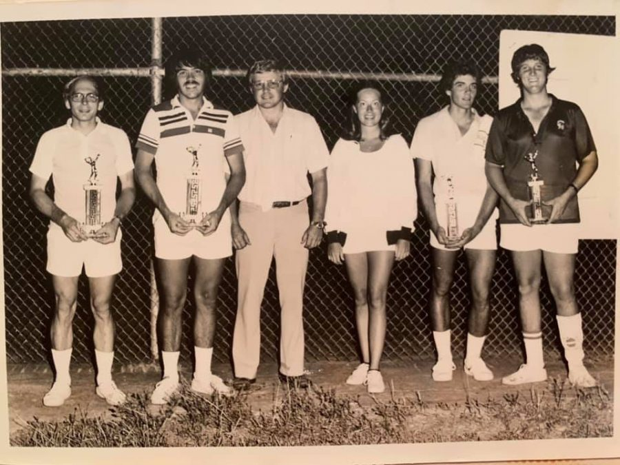 "Mark Lohan, second from left, poses with a trophy in a City of Washington tennis tournament. ""The only time I ever won money off a tournament was a [Pro-Amateur] tournament that I played in Mississippi,"" Lohan said. ""I was paired with an amateur, and we ended up taking first place, and won about $500."" Lohan once ranked #2 in Mississippi in open doubles tennis."