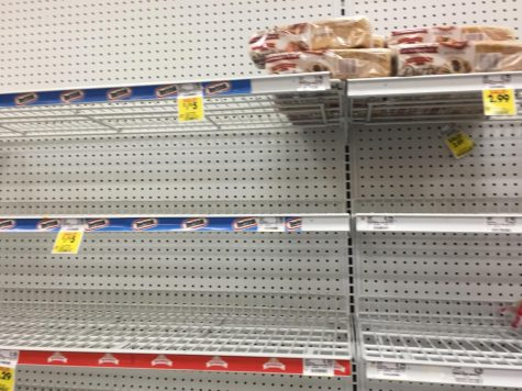 Schnucks is wiped clean of necessities such as bread and other food items as community members prepare for a large outbreak.