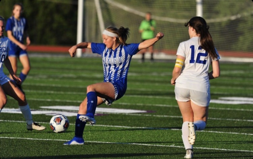 "Senior Sarah Becszlko goes for the ball during her last year as a Blue Jay. ""I don't think I'll ever forget warming up before a game,"" Becszlko said. ""Just singing and dancing while we stretched and got a few touches on the ball while JV played, and just cheering JV on, screaming at the top of our lungs when they scored."" Becszlko does what she can at home to stay in shape, including running and playing soccer with her brother."