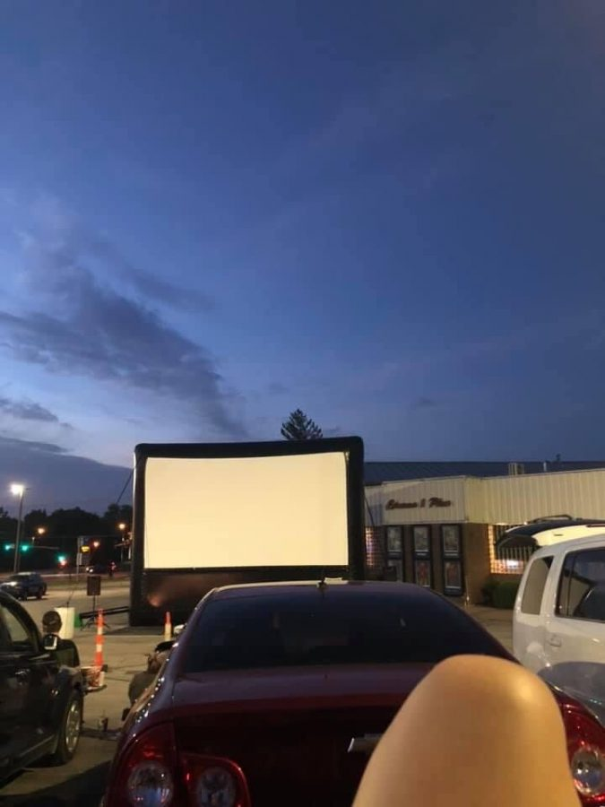 A picture of the movie screen at Cinema 1 Plus  shows the setup for their drive-in movies.