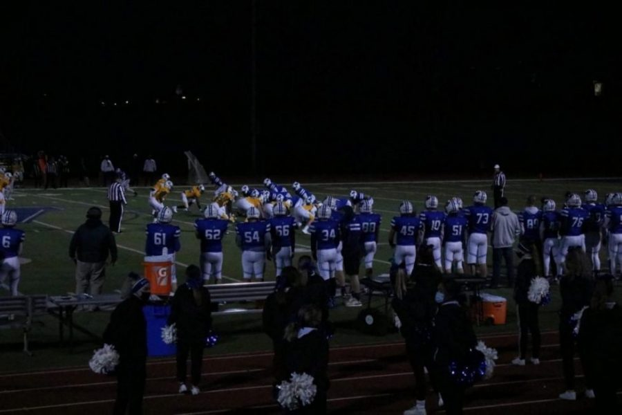 "The Washington football team lines up for a play in the championship versus Battle. ""We are all very excited about last week, but we have to focus on this week,"" junior Cam Millheiser said before the game. Washington would end up losing this game 27-7."