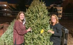 Natalie Nothum poses with her mom after picking out their Christmas tree.