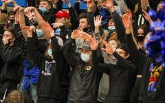 Students cheer on the basketball team earlier this season.