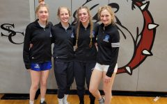 From left, sophomore Julia Donnelly, senior Mia Reed, senior McKenna Deckelman and senior Allison Meyer stand together for a picture after qualifying for state.