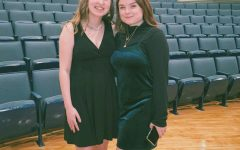 "Seniors Emma Hillermann and Kaylie Rowe pose for a picture after their solos at their live concert March 10. ""'The Sky Above the Roof' was my favorite song because it contained lots of range, but it was also more relatable and was more me,"