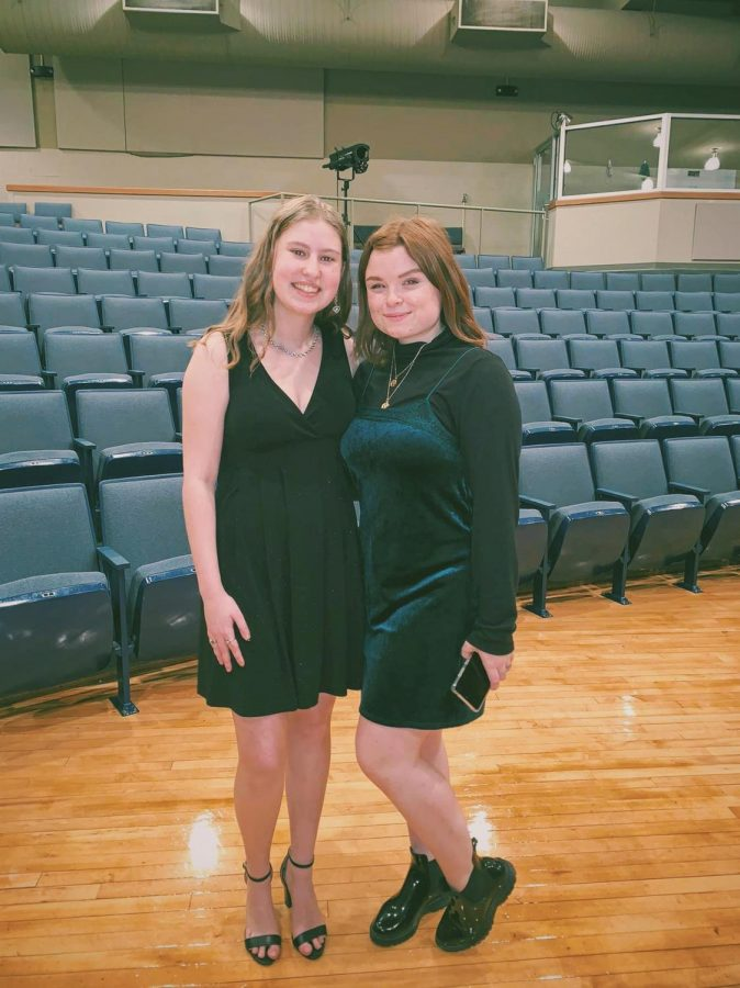 Seniors Emma Hillermann and Kaylie Rowe pose for a picture after their solos at their live concert March 10. ""